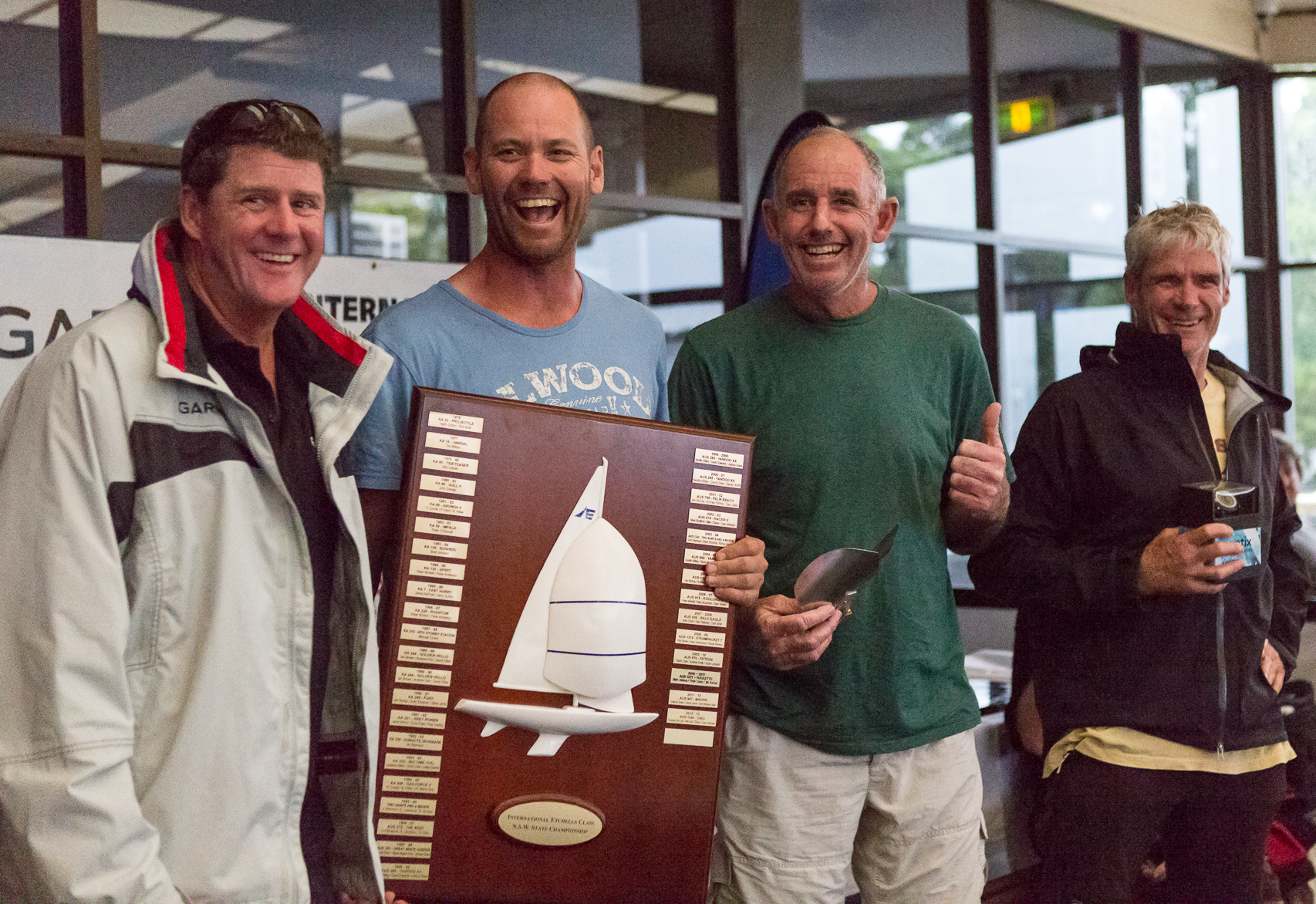 Winners are grinners - none more so than Graeme Taylor, Steve Jarvin and Grant Simmer as Garmin's Jason Browne presented them their loot